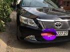 Cần bán Toyota Camry đời 2014, màu đen, xe gia đình mua mới từ hãng Toyota - giá 950tr