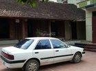 Cần bán xe Mazda 323 đời 1995, màu trắng