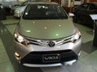 Bán xe Toyota Vios 1.5E đời 2016, màu nâu vàng