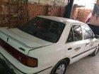 Cần bán lại xe Mazda 323 MT năm 1995, màu trắng