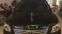 Cần bán gấp Toyota Camry 2.4G đời 2008, màu đen, giá 700tr