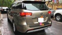 Xe Kia Sedona CRDi 2.2AT đời 2015, màu vàng số tự động