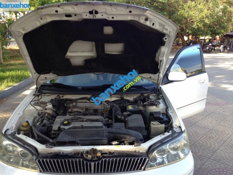 Xe Ford Laser  2003-3